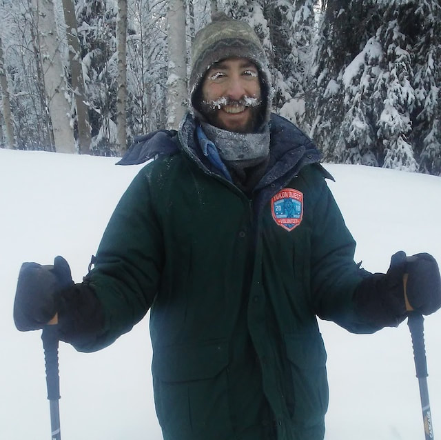 Nature guide Evan on old snowshoes with icy beard